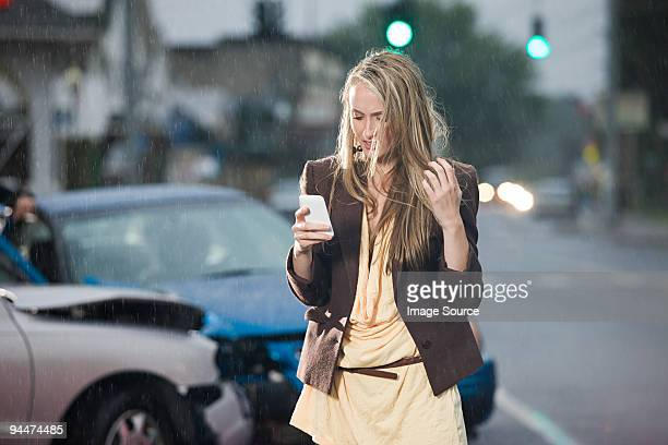 Young woman and car crash