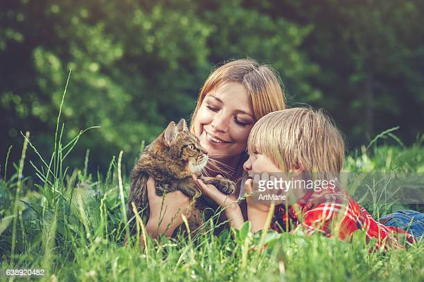 Young woman and child and her cat