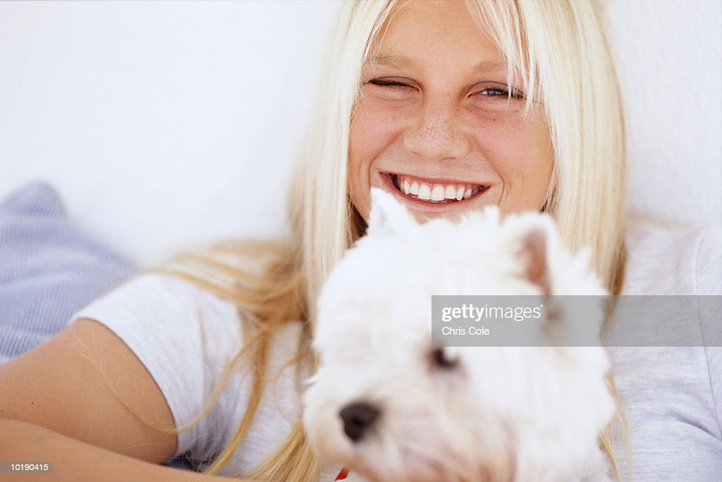 Young woman and dog, portrait, close-up : Stock Photo