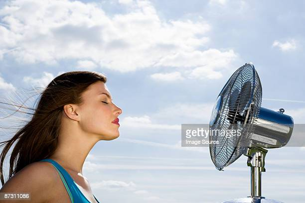 Young woman and fan
