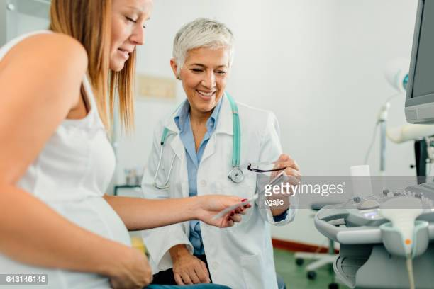 Young Woman And Female Doctor In A Consultation