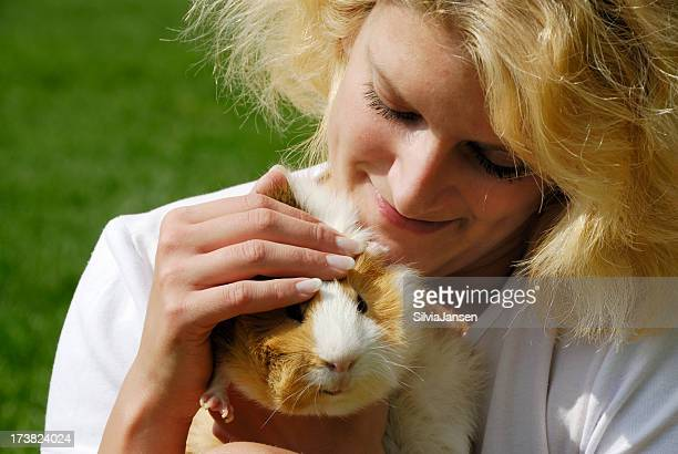 young woman and guinea pig