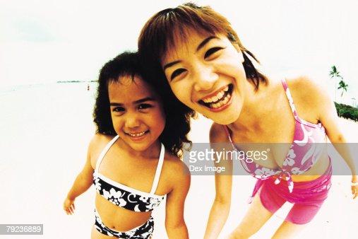 Young woman and Hawaiian girl, smiling : Stock Photo