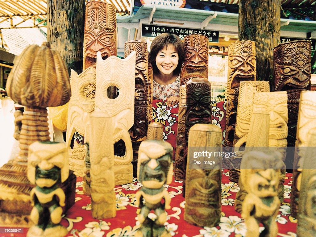 Young woman and Hawaiian handicraft : Stock Photo