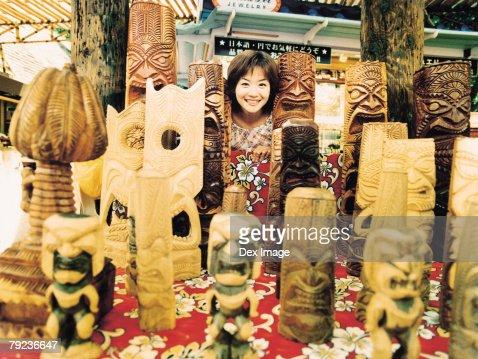 Young woman and Hawaiian handicraft : Stock Photo