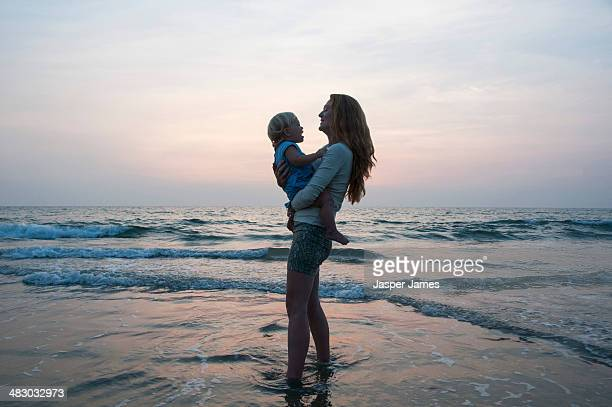 Young woman and her baby at the beach