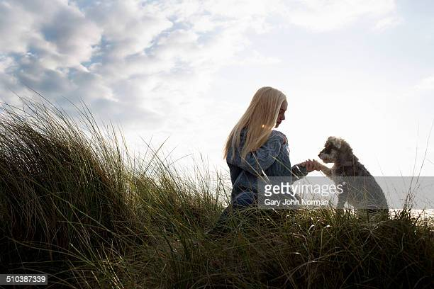 Young woman and her dog at the beach.
