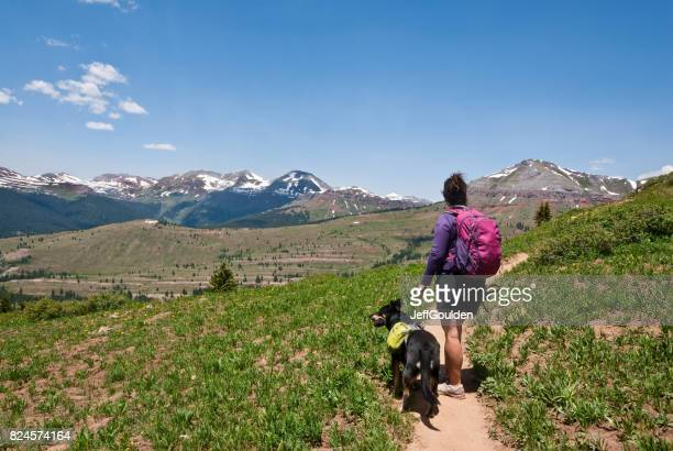 Young Woman Hiker on the Colorado Trail with Her Dog