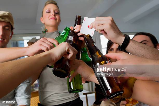 Young woman and her friends toasting with beers