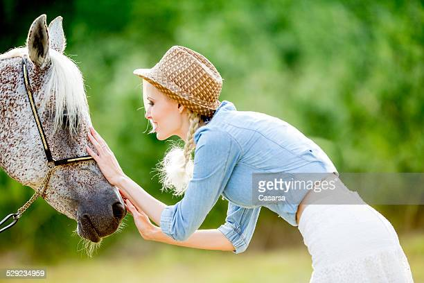 Young woman and her horse