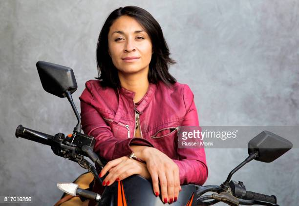 A young woman and her motorbike