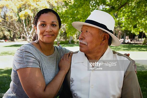 Young woman and her proud father, portrait