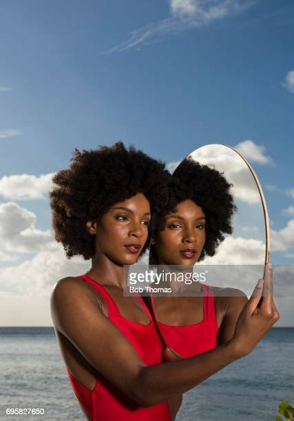 Young Woman And Her Reflection