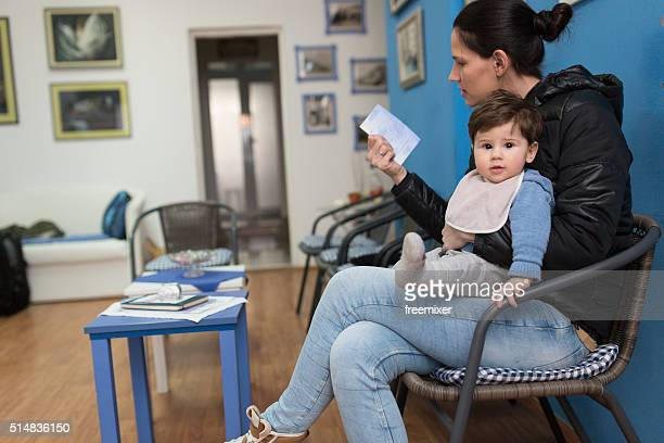 Young woman and her son at the doctor