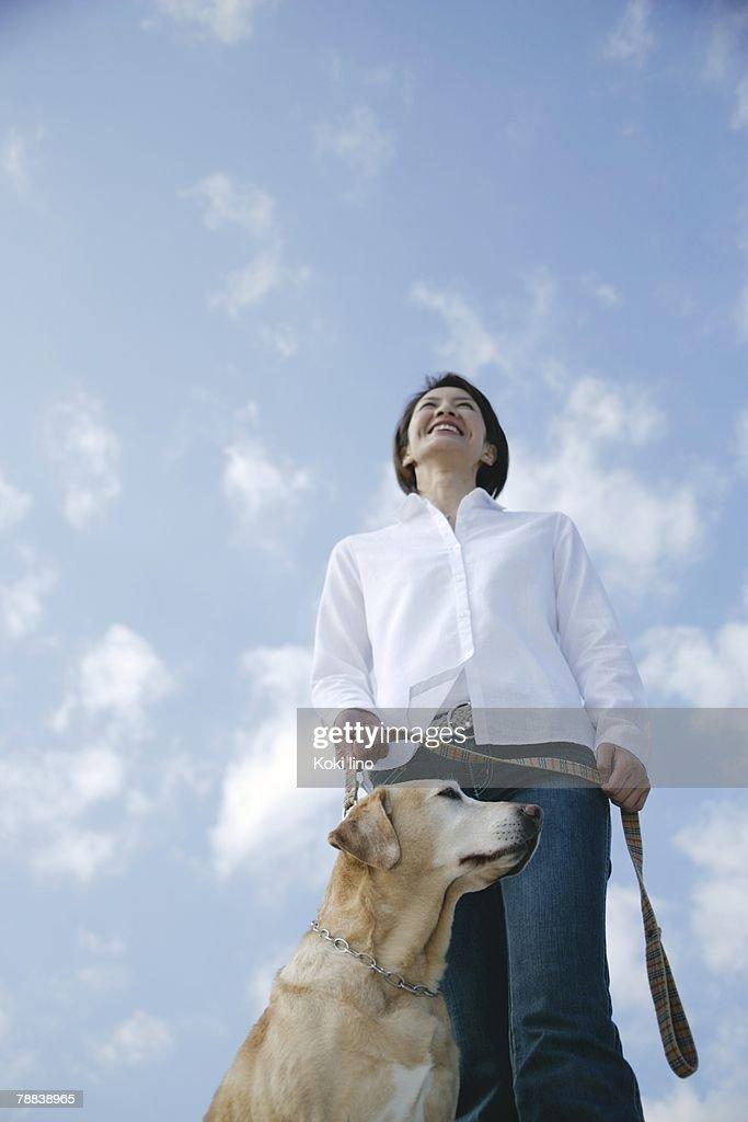 Young woman and Labrador retriever : Stock Photo