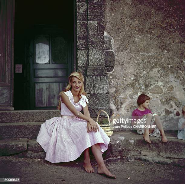 Young woman and little girl seating in the street circa 1950 in Ramatuelle France