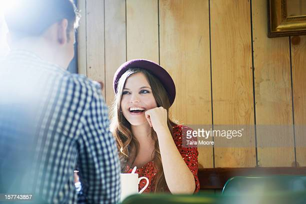 young woman and man chatting in cafe