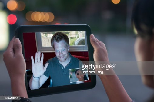 Young woman and man communicating via tablet : Stock Photo