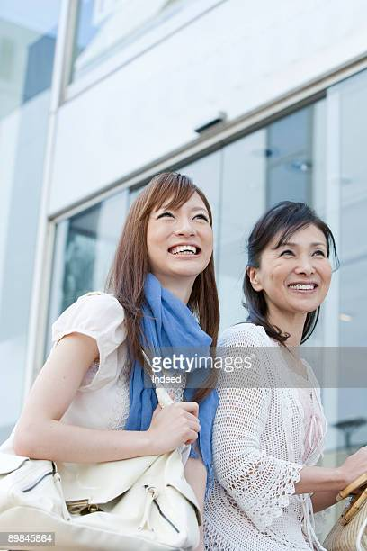 Young woman and mature woman smiling