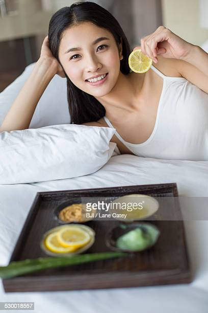 Young woman and natural facial mask
