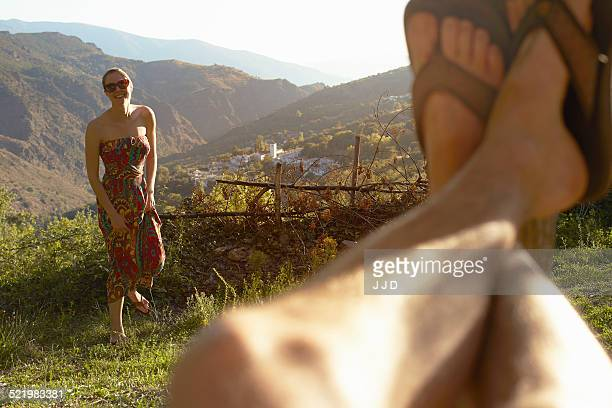 Young woman and selfie of mans legs, Sierra Nevada, Andalucia Granada, Spain