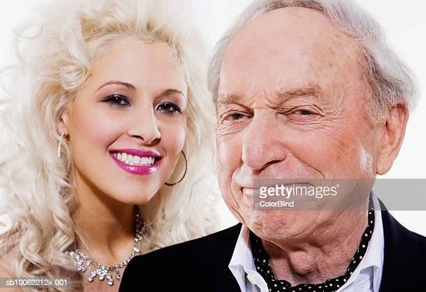 Young woman and senior man smiling, portrait, close-up
