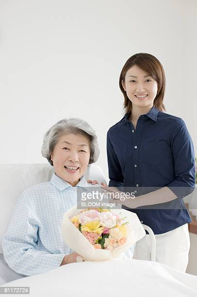 Young woman and senior woman in bed