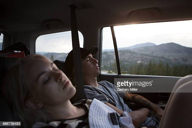 'Young woman and woman asleep in car, Mammoth Lakes, California, USA'