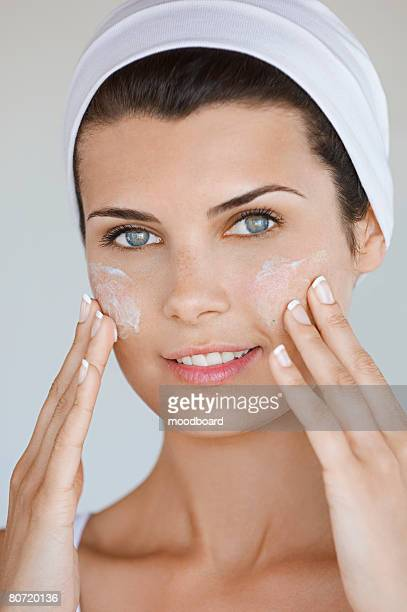 Young Woman Applying Beauty Cream