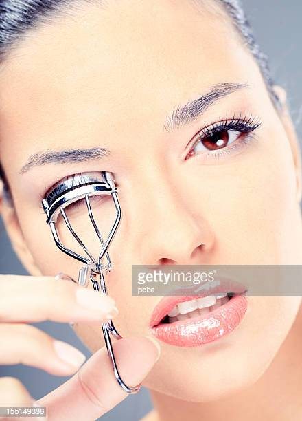 how to use eyelash curler. young woman applying eyelash curler how to use s