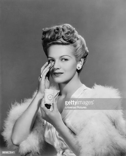 A young woman applying face cream 1943