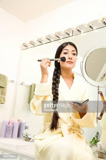 Young Woman Applying Makeup