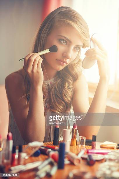 young woman applying make-up