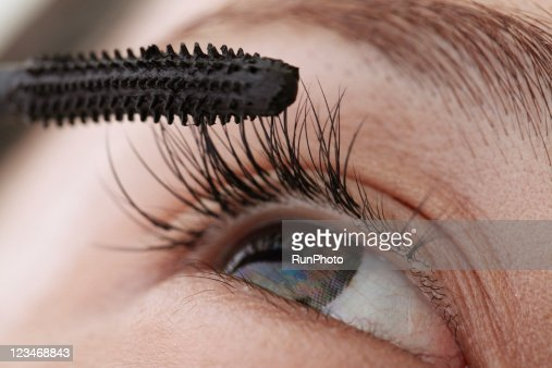 young woman applying mascara,close-up,beauty care : Stock Photo