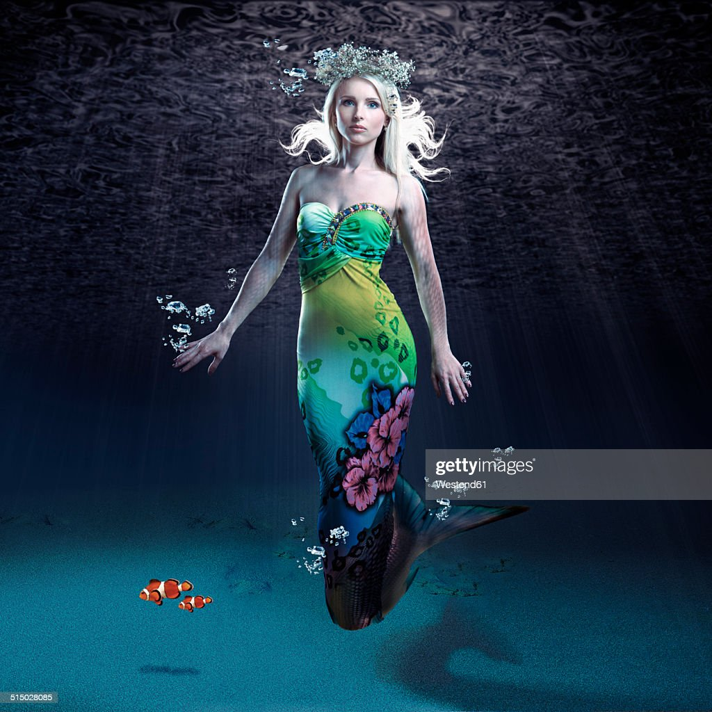 Young woman as mermaid under water
