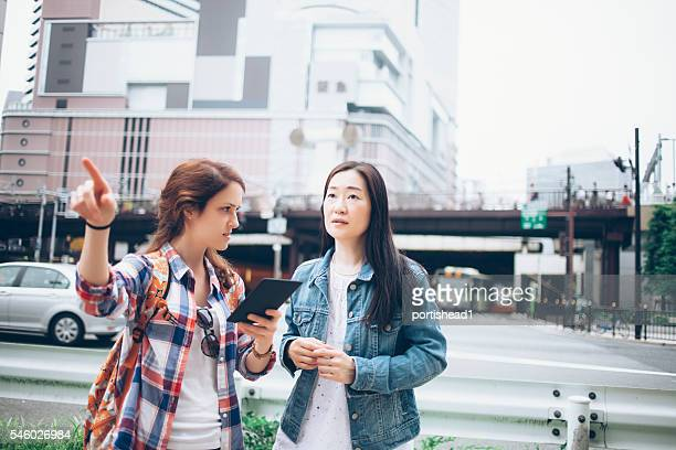 Young woman asking for direction on street