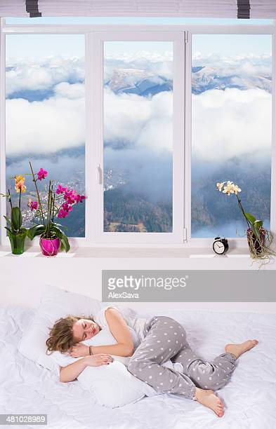 young woman asleep on bed in heaven