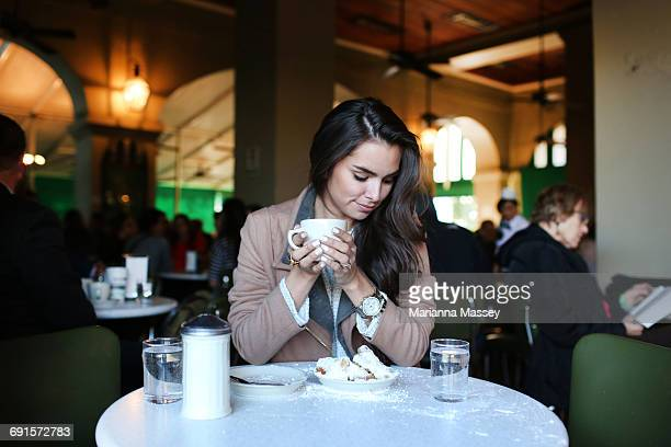 A young woman at a cafe du monde
