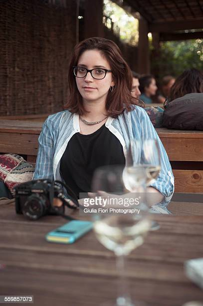 Young woman at a pub table