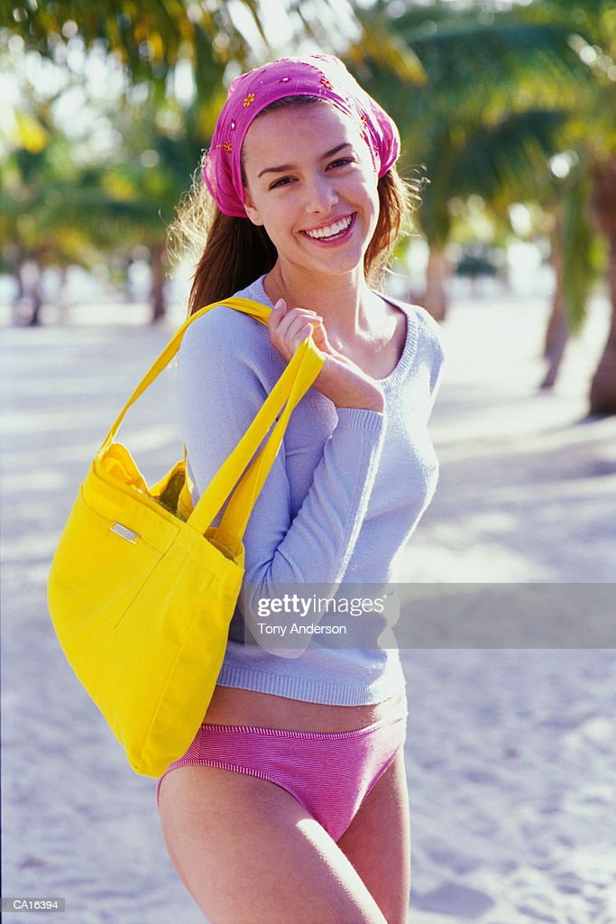Young woman at beach smiling, portrait : Stock Photo