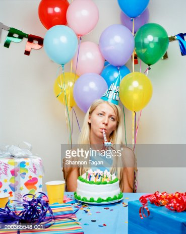Young woman at birthday party : Stock Photo