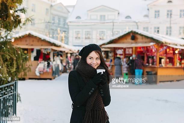Young Woman at Christmas Market
