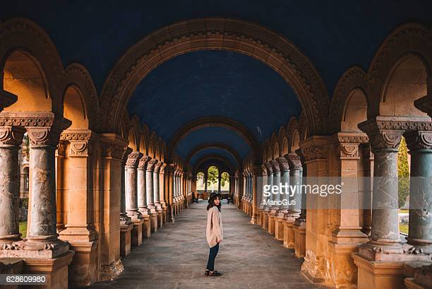 Young woman at cloister