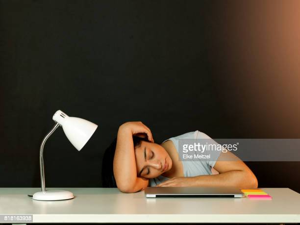 young woman at desk resting