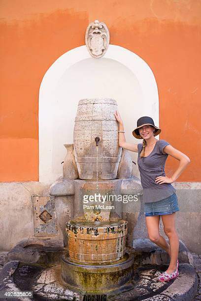Young woman at fountain in Trastevere Rome