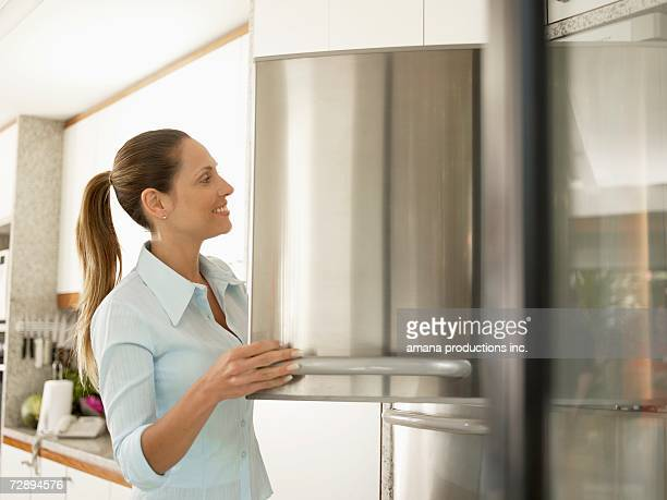 Young woman at freezer