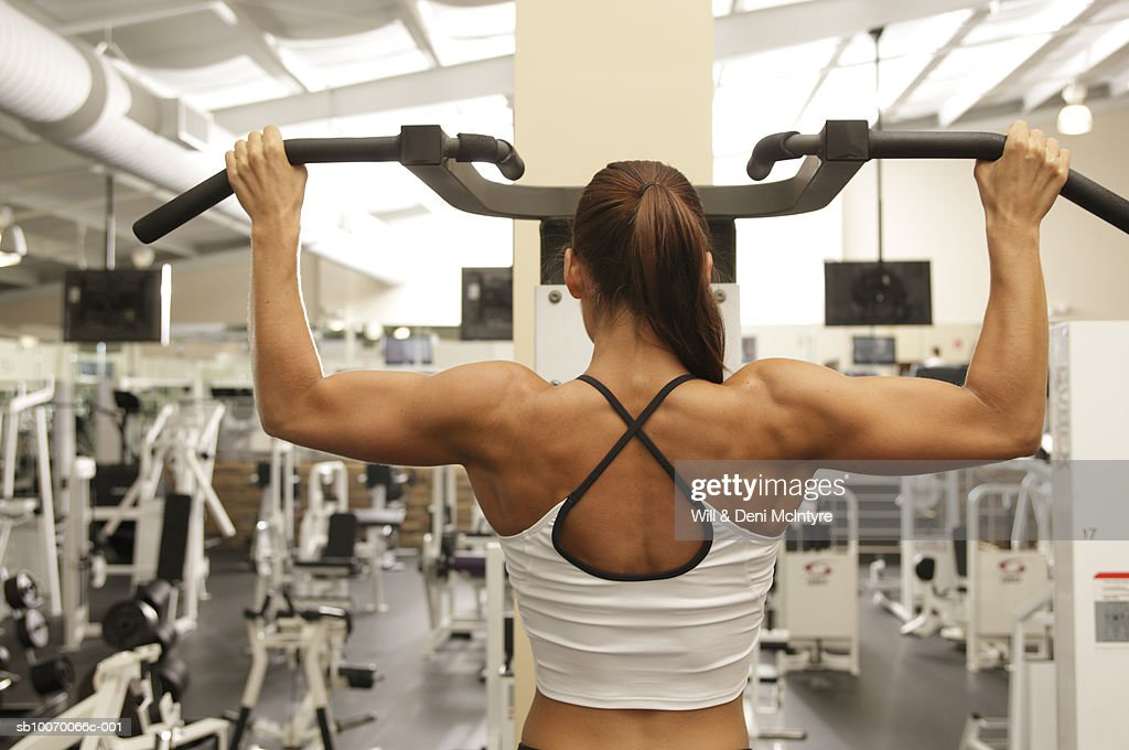 Young woman at health club, rear view : Stock Photo