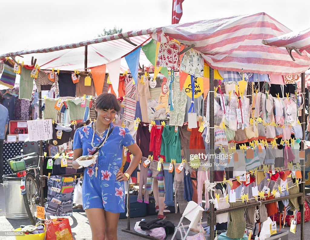 Young woman at her market stall