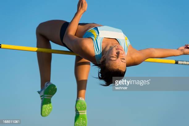 Young woman at high jump