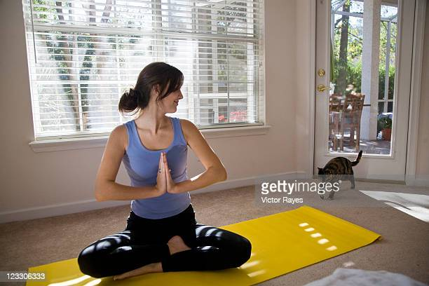 Young woman at home doing yoga